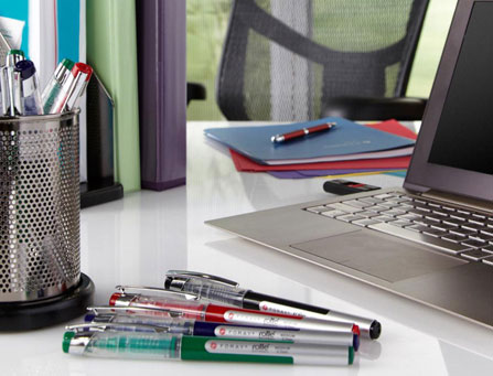 Airy office, supplies on desk
