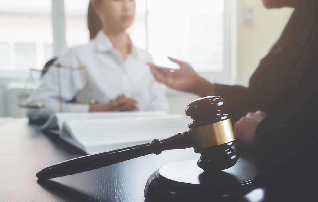 Attorney listening to judge, gavel in foreground